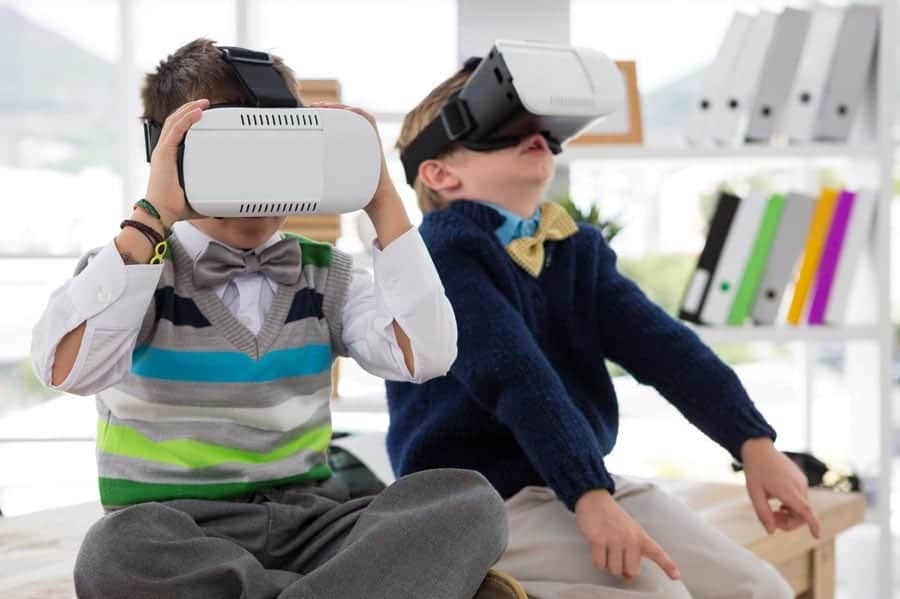 two-students-looking-through-VR-on-a-virtual-field-trip-square