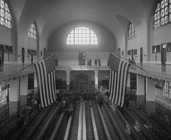 Ellis-Island-Virtual-Tour-The-Registry-Room-Adorned-by-US-flags