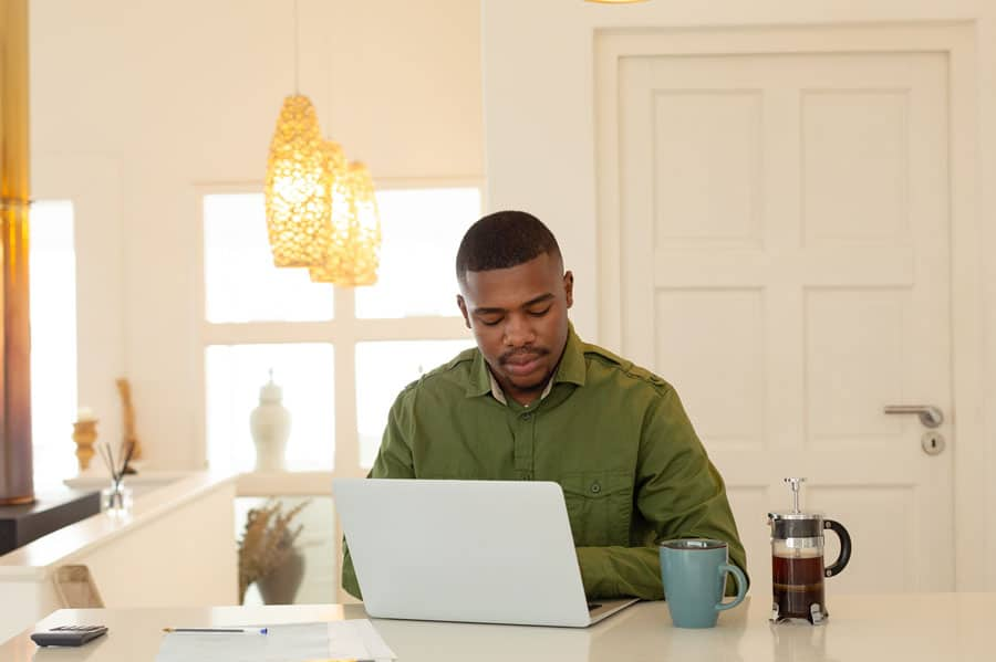 teacher-working-at-home-on-his-lesson-for-students-learning-from-home-square