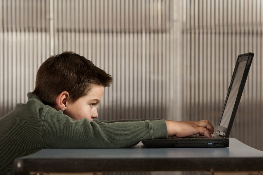 student-engaged-in-remote-learning-online-with-laptop-square